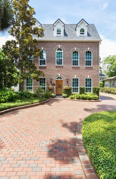 Colonial Style Home with a Brick Paver Driveway