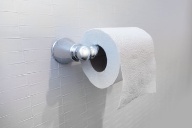 Toilet paper roll on wall bathroom