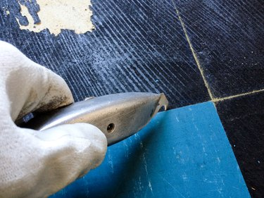 close up of worker removing flooring