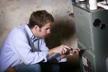 Service Man Working on Furnace