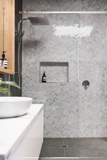 Rain shower with herringbone marble feature tile wall