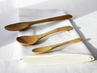 Wooden spoons on folded napkin