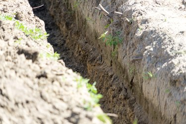 Dig a trench for construction. Place for your text.