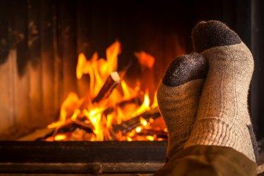 warming feet at fireplace