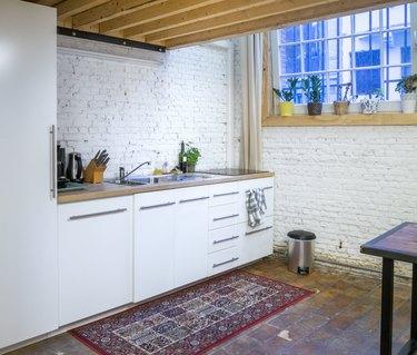contemporary white kitchen in  loft