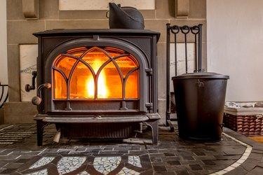 High efficiency cast iron wood stove burning firewood