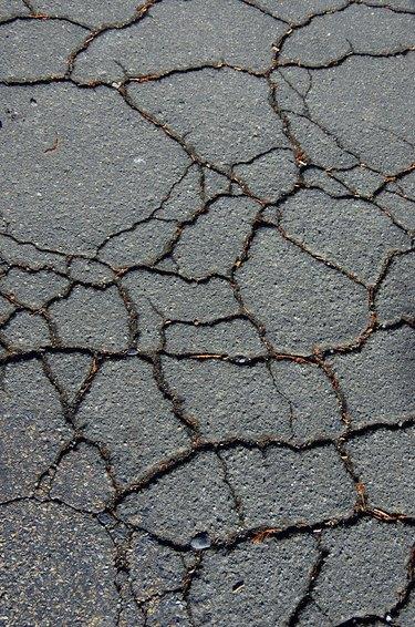 Cracked asphalt road.