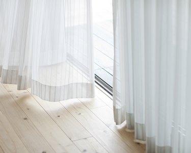 Floor-length white curtains