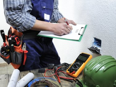 Young electrician working in a residential electrical installation