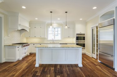 Island and counters in luxury kitchen