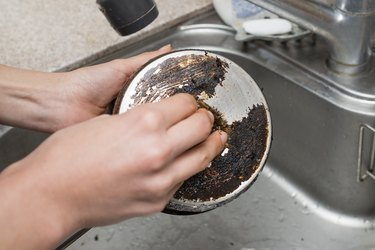 Wash a dirty pot