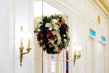 Christmas wreaths on glass window.