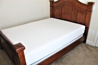 Bed with a foam mattress and  headboad.