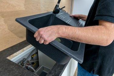 Installing a new ceramic sink in kitchen