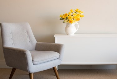 Empty Armchair By Table At Home