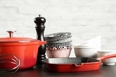 Cookware set: Red enameled cast iron pot, saucepan and bowls