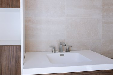Modern sink made of contemporary minimalist washbasin with chrome batteries