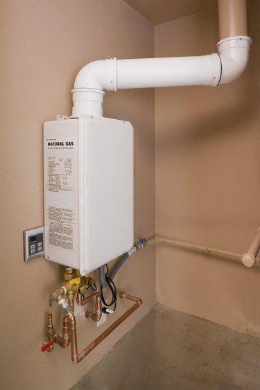 Tankless water heater attached wall.