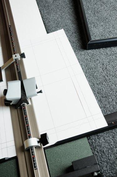 Close up of matboard cutting machine