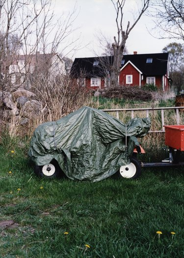 Tractor with plastic rain cover