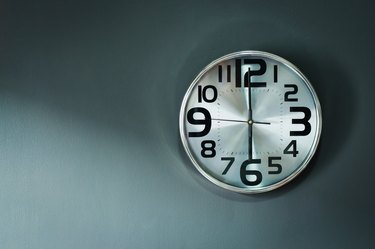 Silver wall alarm clock.