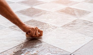 Cleaning the tile floor.