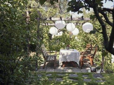 Table set in garden.