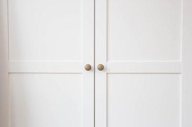 White closet doors wood closeup