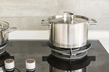 Gas stove and stainless steel pot in kitchen