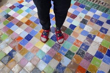 Multi coloured tile floor.