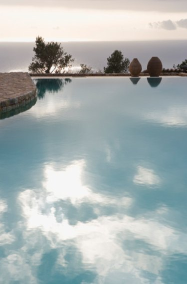 Swimming pool reflecting sky.