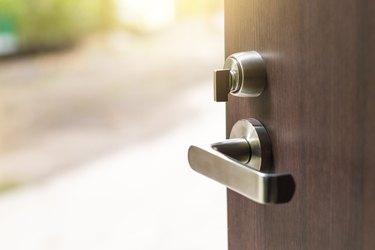 Open the modern wooden door