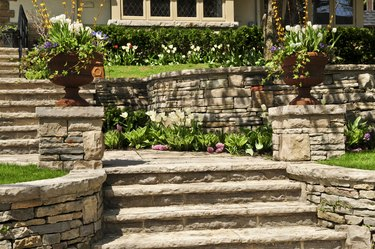 Natural stone landscaping of walls and steps outside house