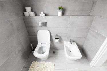 White ceramic bidet and toilet at luxury bathroom