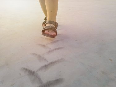Children are walking on Tire tread pattern on concrete floor.Happy time.