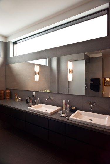 Luxury bathroom with dark laminate countertop