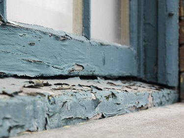 Peeling paint on old window sill