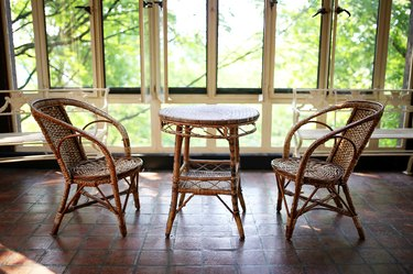 Old Wicker Bistro Table and Chairs in Sun Room Patio of Historic House