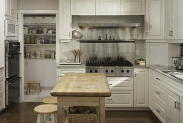 Wooden counter and stove in modern kitchen