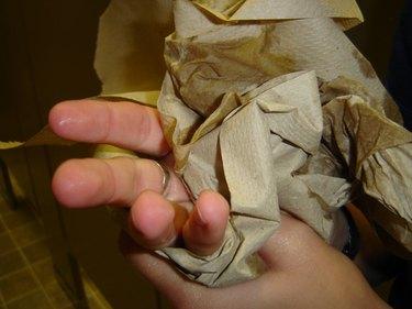 Paper towel wiping hands.