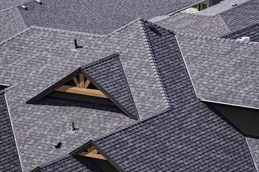 Rooftop in a newly constructed subdivision showing asphalt shingles