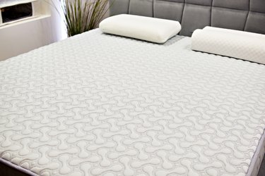 White mattress on double bed