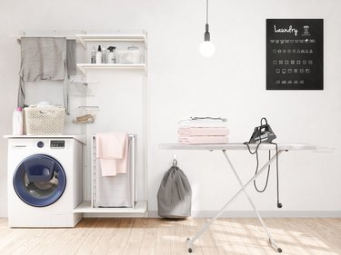 Laundry room with washer, iron, iron board