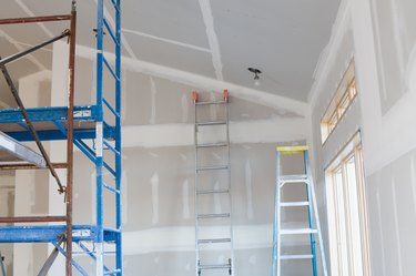 Drywall Taping, Scaffold, and Ladders in New Home Under Construction