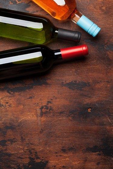 Various wine bottles on wooden table