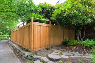 New Cedar Wood Fence around house side yard landscaping