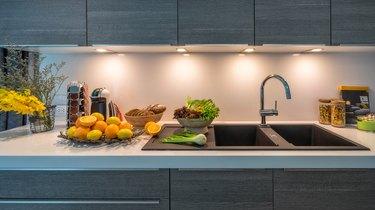 Kitchen sink in modern house kitchen with vegetables. Internal view of a modern kitchen. Interior design kitchen beautiful perspective. Quick to prepare meals.