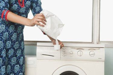 Mid section view of a woman doing laundry