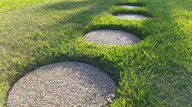 Stepping Stones On Grassy Field
