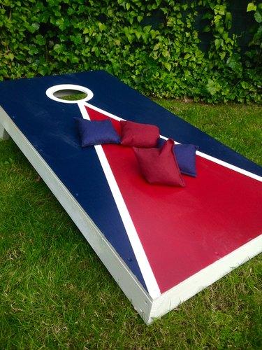 Cornhole Toss Game Board on Grass in Summer